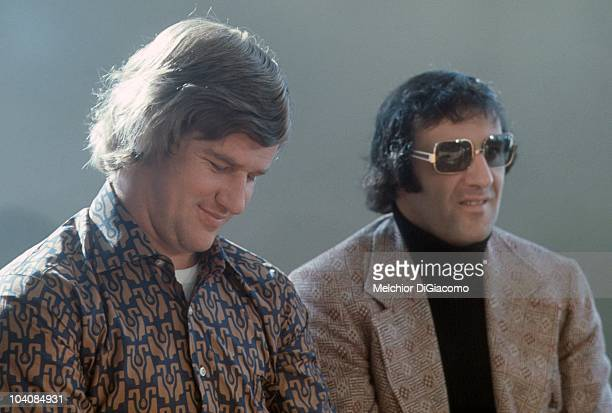 Bobby Orr and Phil Esposito of Canada look on in street clothes during the 1972 Summit Series in September 1972 in Moscow Russia