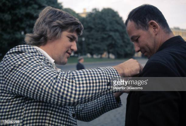 Bobby Orr of Canada exchanges pins with a fan in the streets of Moscow during the 1972 Summit Series in Moscow Russia