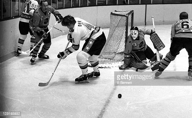 Bobby Orr of the Boston Bruins and Team East looks to control the puck as goalie Tony Esposito of the Chicago Blackhawks and Team West defends the...