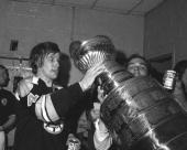 Bobby Orr of the Boston Bruins drinks from the Stanley Cup after Boston defeated the New York Rangers in Game 6 of the 1972 Stanley Cup Finals on May...