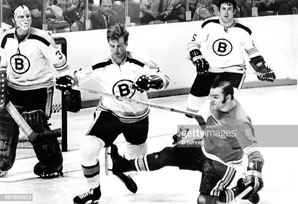 Bobby Orr of the Boston Bruins is tripped by Bob Plager of the St Louis Blues as Orr's teammates goalie Gerry Cheevers and Don Awrey look on during...