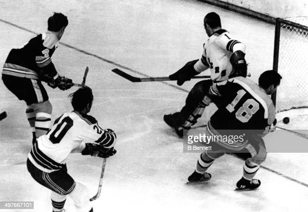 Bobby Orr of the Boston Bruins scores on goalie Ed Giacomin of the New York Rangers during Game 5 of the 1970 Quarter Finals on April 14 1970 at the...