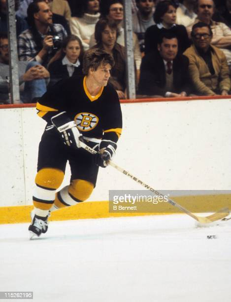 Bobby Orr of the Boston Bruins skates with the puck during an NHL game circa 1975