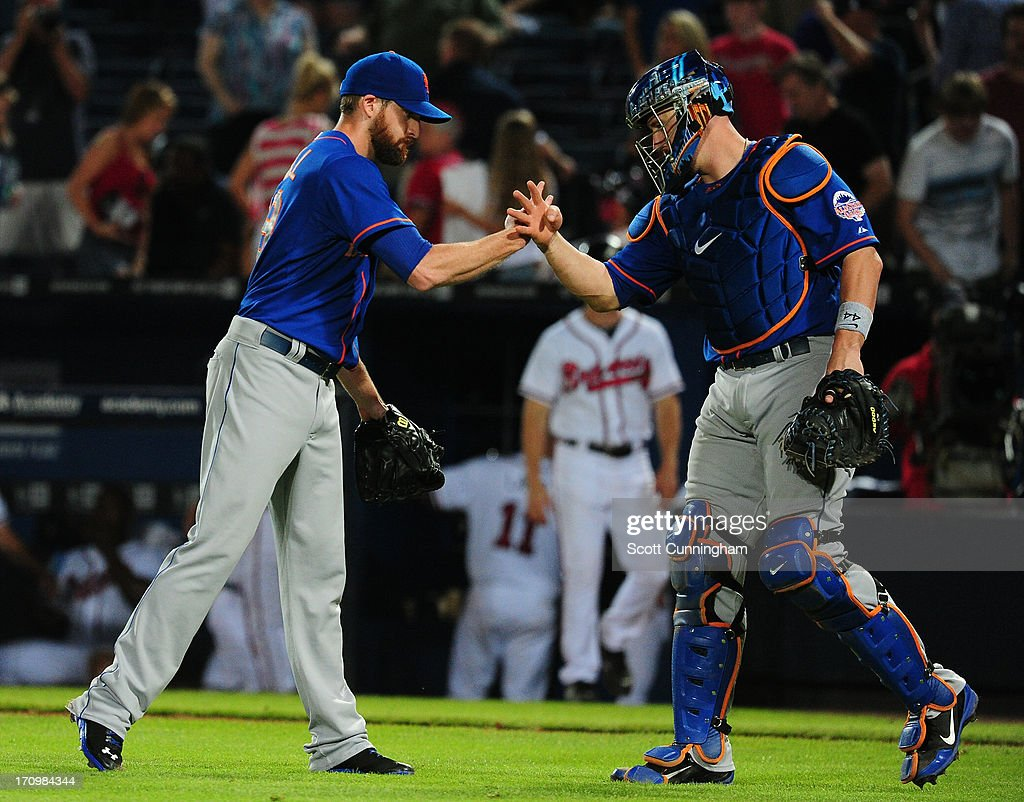 Bobby Parnell #39 and John Buck #44 of the New York Mets celebrate after the game against the Atlanta Braves at Turner Field on June 20, 2013 in Atlanta, Georgia.