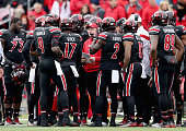 Bobby Petrino the head coach of the Louisville Cardinals gives instructions to his team during the game against the Kentucky Wildcats at Papa John's...