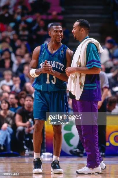 Bobby Phills and Dell Curry of the Charlotte Hornets talk on court during the game against the Boston Celtics at the Boston Garden in Boston...