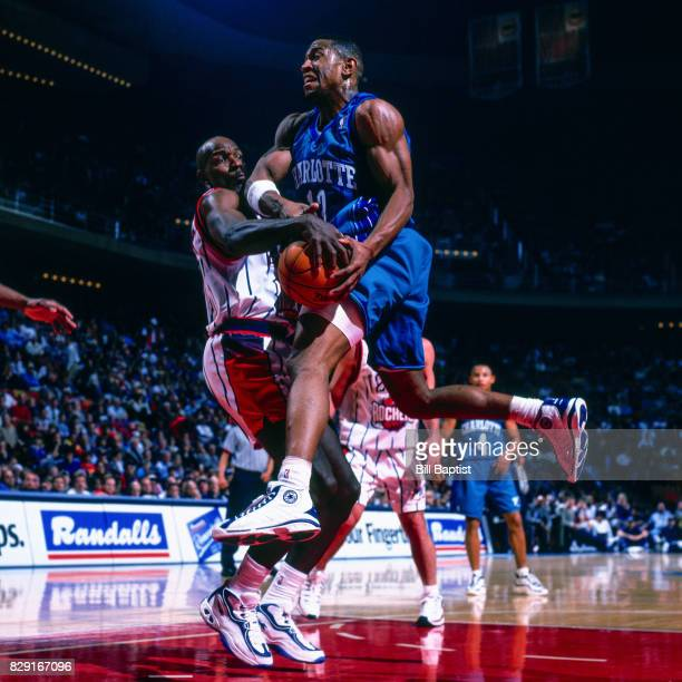 Bobby Phills of the Charlotte Hornets drives to the basket while guarded by Hakeem Olajuwon of the Houston Rockets at The Summit in Houston Texas...