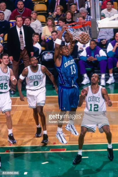 Bobby Phills of the Charlotte Hornets dunks the ball against the Boston Celtics at the Boston Garden in Boston Massachusetts circa 1998 NOTE TO USER...