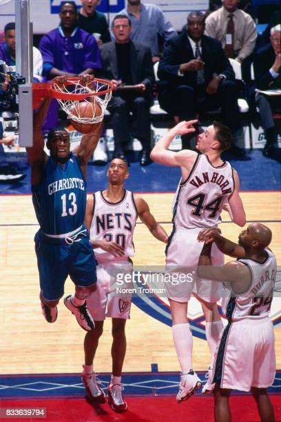 Bobby Phills of the Charlotte Hornets dunks the ball against the New Jersey Nets at the Continental Airlines Arena in East Rutherford New Jersey...