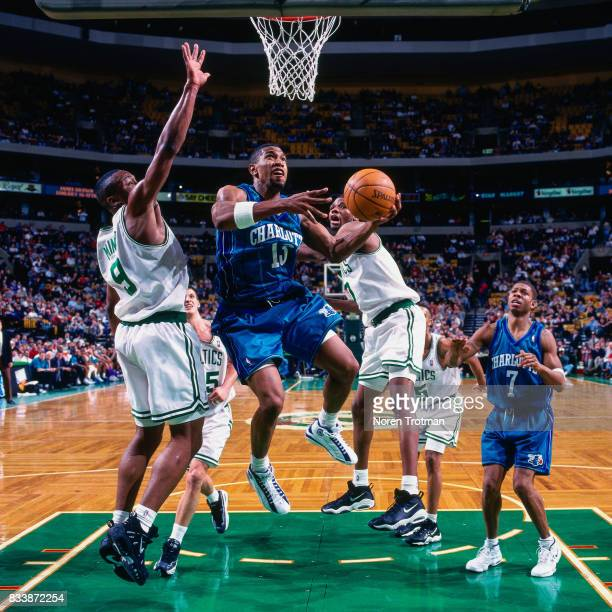 Bobby Phills of the Charlotte Hornets passes the ball against the Boston Celtics at the Boston Garden in Boston Massachusetts circa 1998 NOTE TO USER...