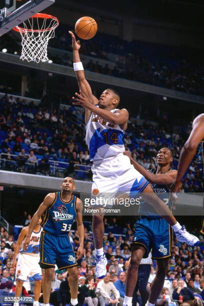 Bobby Phills of the Cleveland Cavaliers drives to the basket and shoots the ball at Gund Arena in Cleveland Ohio circa 1997 NOTE TO USER User...