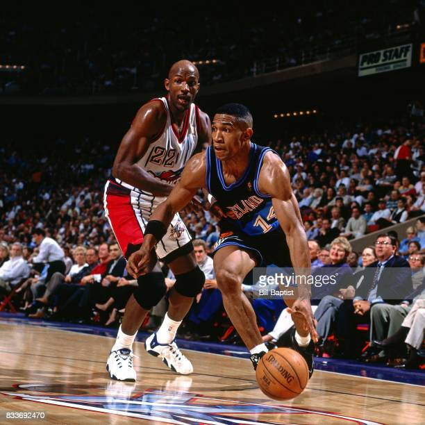 Bobby Phills of the Cleveland Cavaliers drives to the basket while guarded by Clyde Drexler of the Houston Rockets at The Summit in Houston Texas...