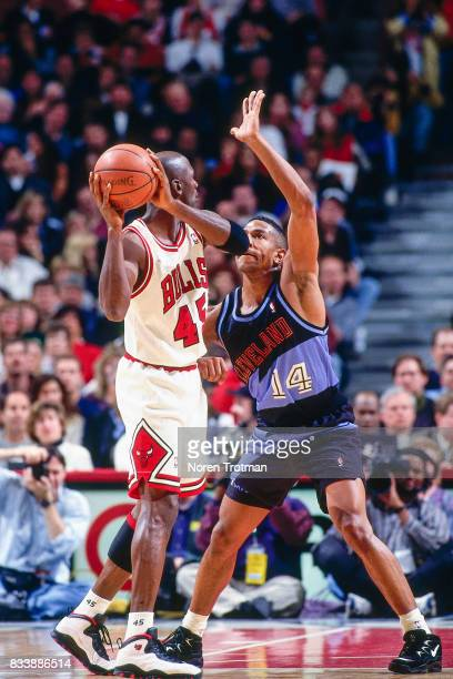 Bobby Phills of the Charlotte Hornets guards Michael Jordan of the Chicago Bulls at the United Center in Chicago Illinois circa 1995 NOTE TO USER...