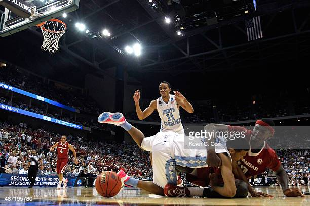 Bobby Portis of the Arkansas Razorbacks and Nate Britt of the North Carolina Tar Heels battle for the ball in the first half during the third round...