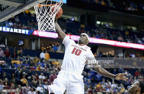 Bobby Portis of the Arkansas Razorbacks dunks the ball against the Tennessee Volunteers during the quaterfinals of the SEC Basketball Tournament at...