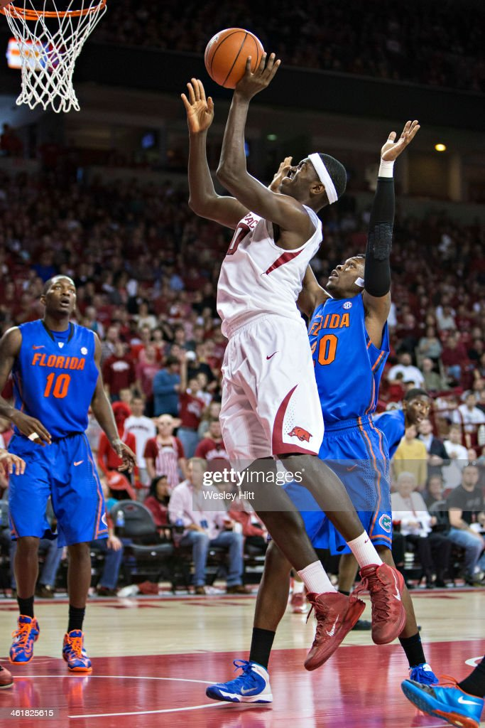 Bobby Portis #10 of the Arkansas Razorbacks goes up for a shot past Michael Frazier II #20 of the Florida Gators at Bud Walton Arena on January 11, 2014 in Fayetteville, Arkansas. The Gators defeated the Razorbacks 84-82.