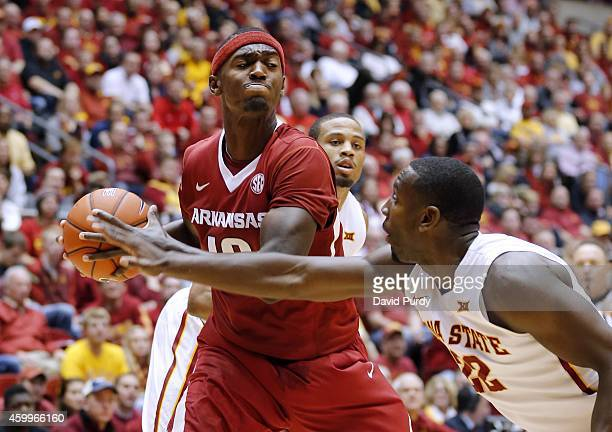 Bobby Portis of the Arkansas Razorbacks pulls in a rebound over Dustin Hogue of the Iowa State Cyclones in the second half of play at Hilton Coliseum...