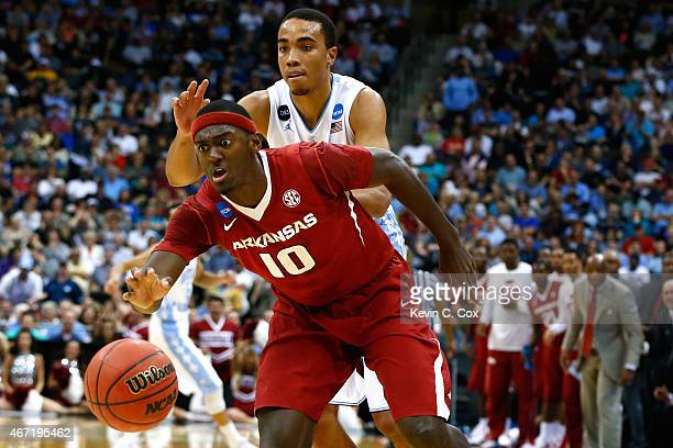 Bobby Portis of the Arkansas Razorbacks steals the ball from Brice Johnson of the North Carolina Tar Heels in the first half during the third round...