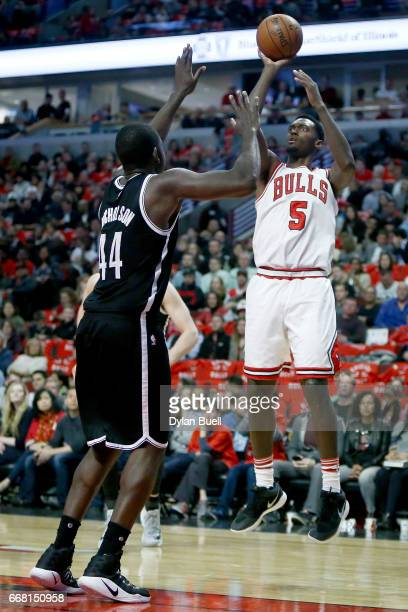 Bobby Portis of the Chicago Bulls attempts a shot while being guarded by Andrew Nicholson of the Brooklyn Nets in the second quarter at United Center...