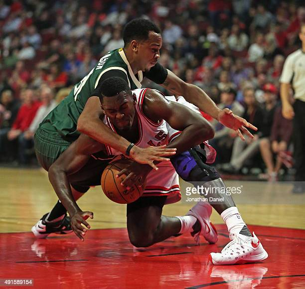 Bobby Portis of the Chicago Bulls battles for the ball with John Henson of the Milwaukee Bucks during a preseason game at the United Center on...