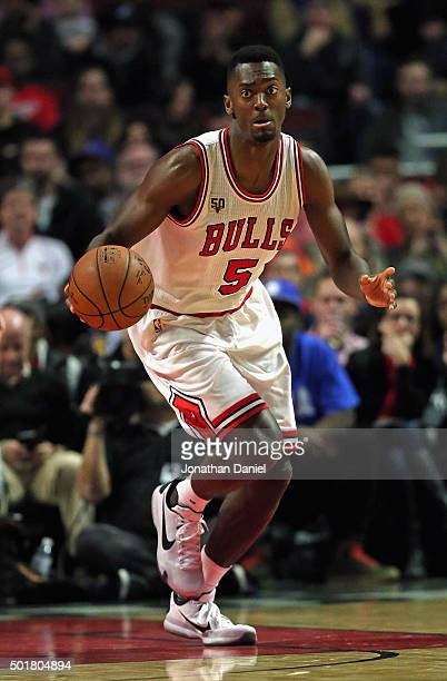 Bobby Portis of the Chicago Bulls brings the ball up the court against the Philadelphia 76ers at the United Center on December 14 2015 in Chicago...