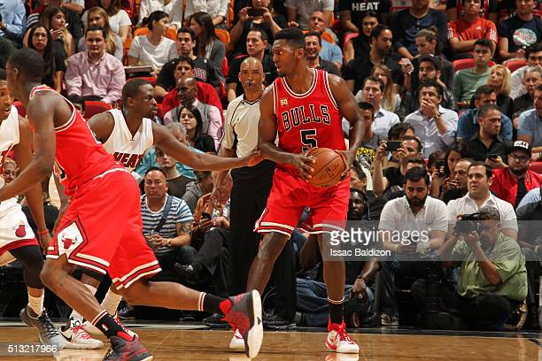 Bobby Portis of the Chicago Bulls defends the ball against the Miami Heat during the game on March 1 2016 at American Airlines Arena in Miami Florida...