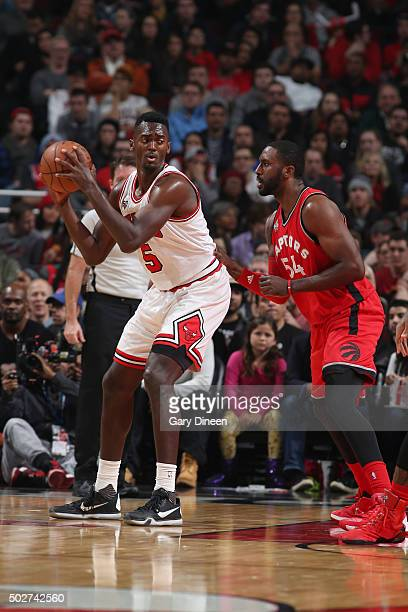 Bobby Portis of the Chicago Bulls defends the ball against the Toronto Raptors during the game on December 28 2015 at United Center in Chicago...