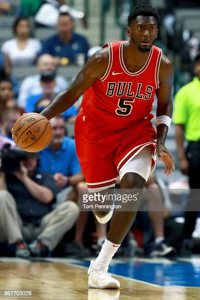 Bobby Portis of the Chicago Bulls dribbles the ball against the Dallas Mavericks at American Airlines Center on October 4 2017 in Dallas Texas NOTE...