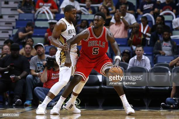 Bobby Portis of the Chicago Bulls drives against Darius Miller of the New Orleans Pelicans during a preseason game at the Smoothie King Center on...