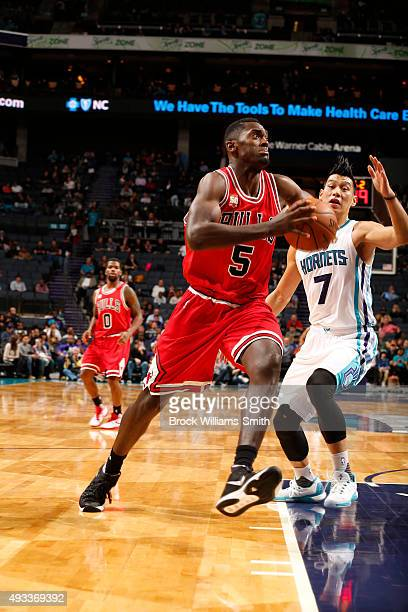 Bobby Portis of the Chicago Bulls drives to the basket against the Charlotte Hornets during a preseason game at the Time Warner Cable Arena on...