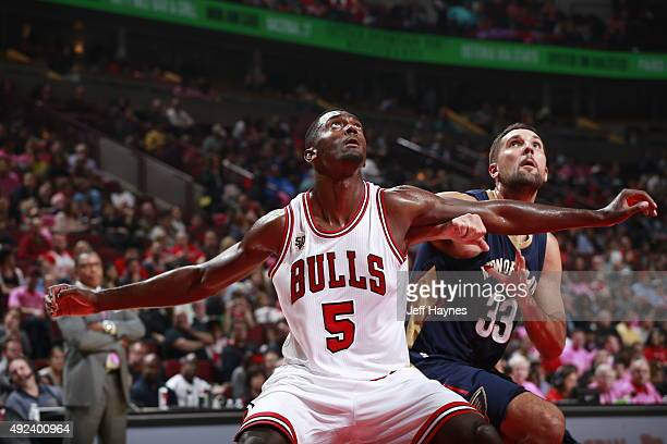 Bobby Portis of the Chicago Bulls fights for position against Ryan Anderson of the New Orleans Pelicans on October 12 2015 at the United Center in...