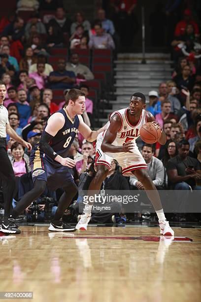 Bobby Portis of the Chicago Bulls handles the ball against Luke Babbitt of the New Orleans Pelicans on October 12 2015 at the United Center in...