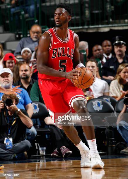 Bobby Portis of the Chicago Bulls handles the ball against the Dallas Mavericks on October 4 2017 at the American Airlines Center in Dallas Texas...