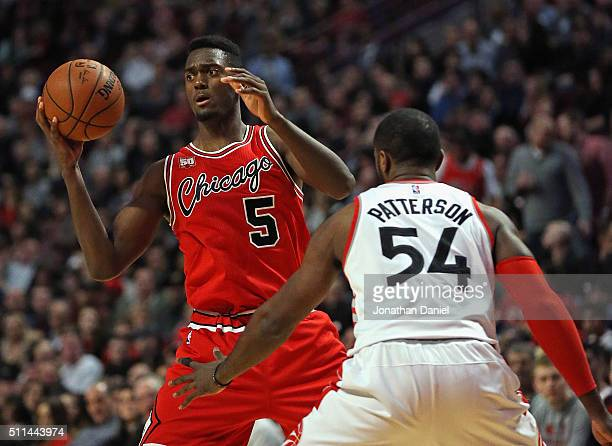 Bobby Portis of the Chicago Bulls looks to pas under pressure from Patrick Patterson of the Toronto Raptors at the United Center on February 19 2016...