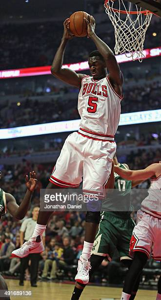 Bobby Portis of the Chicago Bulls rebounds against the Milwaukee Bucks during a preseason game at the United Center on October 6 2015 in Chicago...