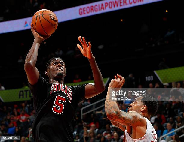 Bobby Portis of the Chicago Bulls shoots against Mike Scott of the Atlanta Hawks at Philips Arena on January 20 2017 in Atlanta Georgia NOTE TO USER...