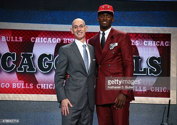 Bobby Portis shakes hands with NBA Commissioner Adam Silver after being selected number twenty two overall by the Chicago Bulls during the 2015 NBA...
