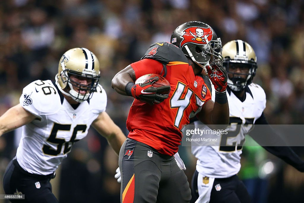 <a gi-track='captionPersonalityLinkClicked' href=/galleries/search?phrase=Bobby+Rainey&family=editorial&specificpeople=5555205 ng-click='$event.stopPropagation()'>Bobby Rainey</a> #43 of the Tampa Bay Buccaneers is pursued by <a gi-track='captionPersonalityLinkClicked' href=/galleries/search?phrase=Michael+Mauti&family=editorial&specificpeople=5630085 ng-click='$event.stopPropagation()'>Michael Mauti</a> #56 and <a gi-track='captionPersonalityLinkClicked' href=/galleries/search?phrase=Damian+Swann&family=editorial&specificpeople=9717888 ng-click='$event.stopPropagation()'>Damian Swann</a> #27 of the New Orleans Saints during the third quarter of a game at the Mercedes-Benz Superdome on September 20, 2015 in New Orleans, Louisiana.