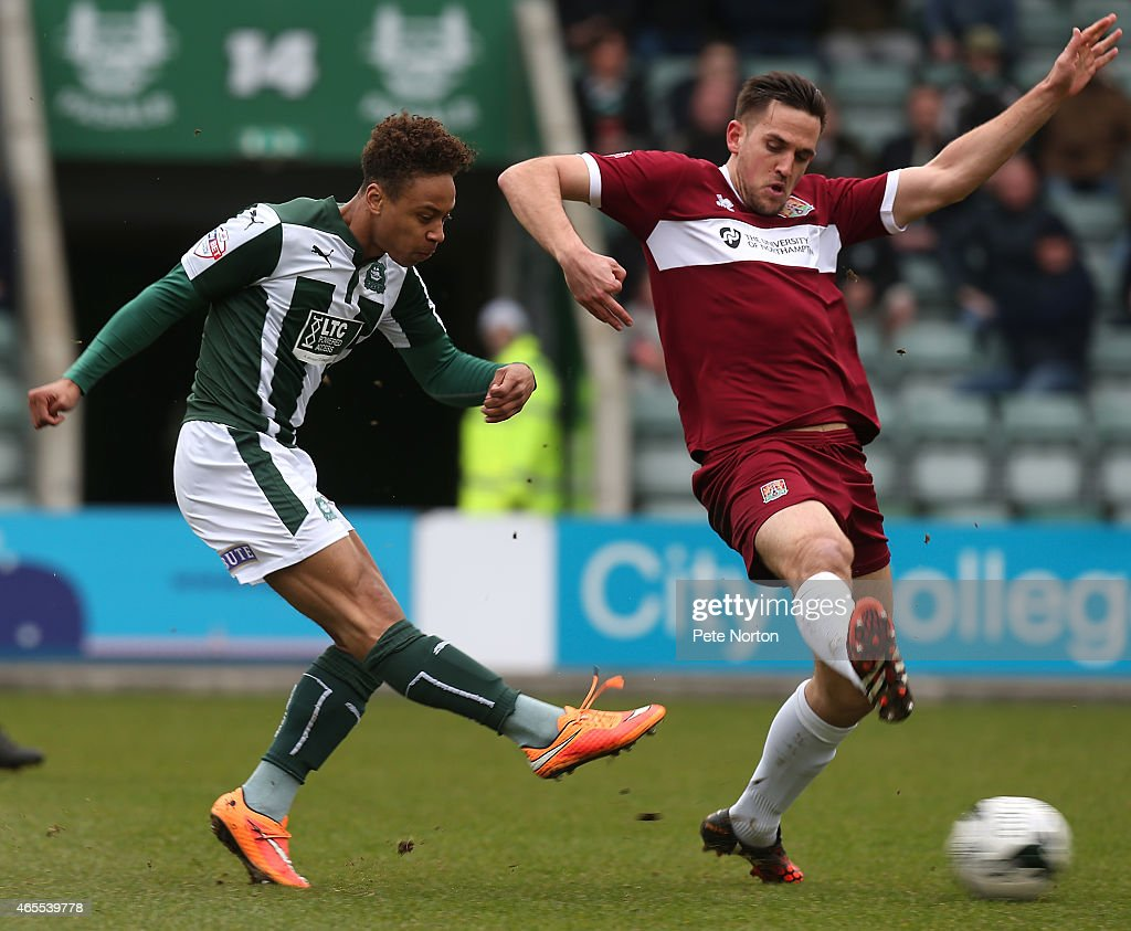 Bobby Reid Of Plymouth Argyle Has A Shot At Goal Past Darren Carter Northampotn Town