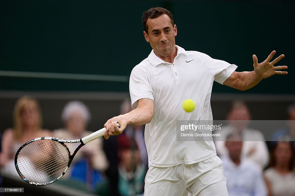 Bobby Reynolds of the United States of America plays a forehand during his Gentlemen's Singles second round match against Novak Djokovic of Serbia on day four of the Wimbledon Lawn Tennis Championships at the All England Lawn Tennis and Croquet Club on June 27, 2013 in London, England.