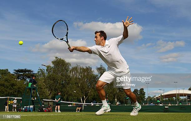 Bobby Reynolds of USA stretches for a backhand in his match against CharlesAntoine Brezac of France during day one of the Wimbledon Championships...