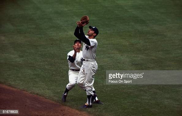 Bobby Richardson and Joe Pepitone of the New York Yankees reach for a pop fly at Yankee Stadium in Bronx New York