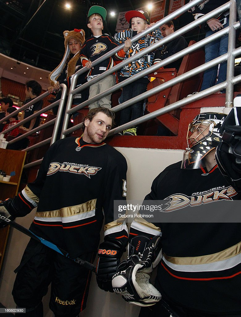 Bobby Ryan #9 and Jonas Hiller #1of the Anaheim Ducks talk before the game against the Minnesota Wild on February 1, 2013 at Honda Center in Anaheim, California.