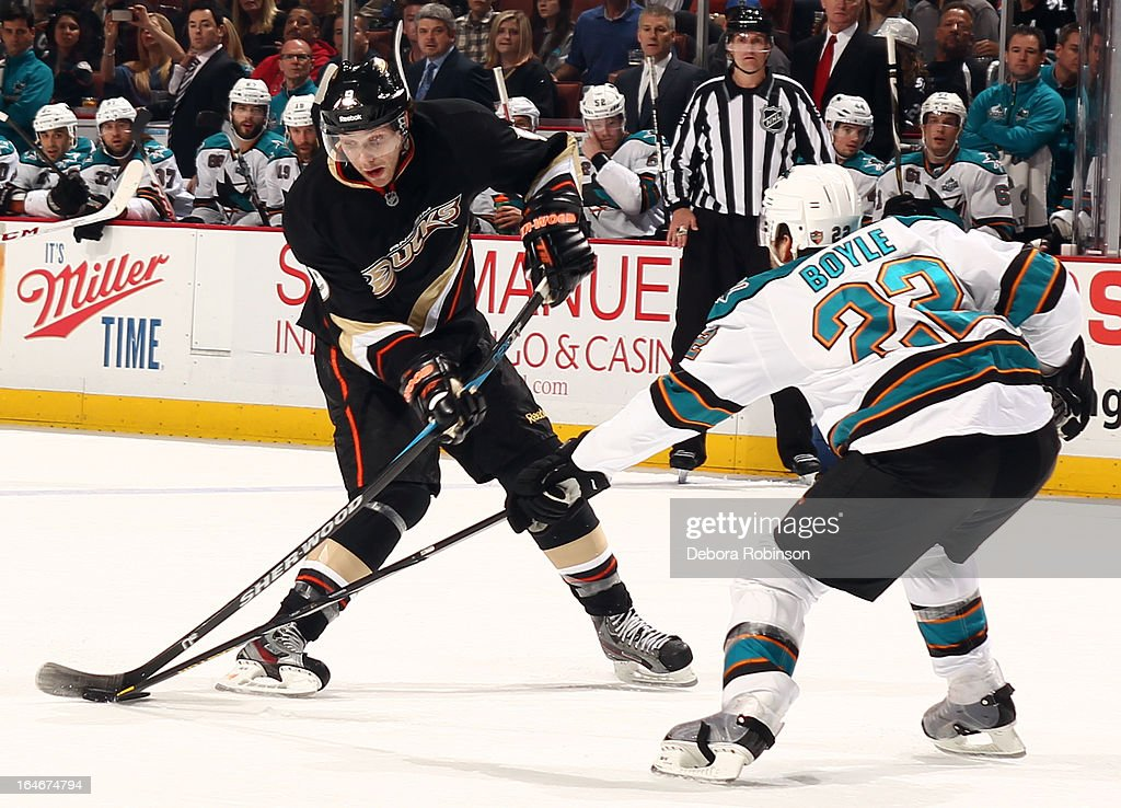 Bobby Ryan #9 of the Anaheim Ducks battles for the puck against Dan Boyle #22 of the San Jose Sharks on March 25, 2013 at Honda Center in Anaheim, California.