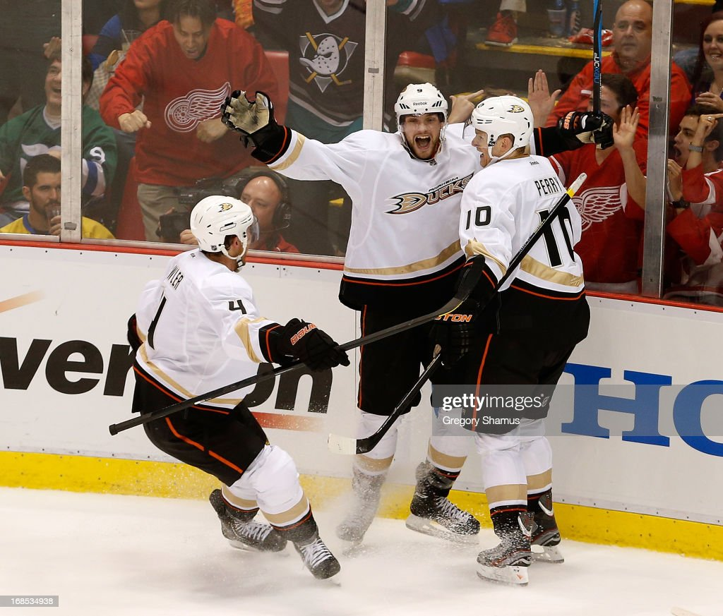<a gi-track='captionPersonalityLinkClicked' href=/galleries/search?phrase=Bobby+Ryan+-+Ice+Hockey+Player&family=editorial&specificpeople=877359 ng-click='$event.stopPropagation()'>Bobby Ryan</a> #9 of the Anaheim Ducks celebrates his third-period goal with teammates <a gi-track='captionPersonalityLinkClicked' href=/galleries/search?phrase=Corey+Perry&family=editorial&specificpeople=213864 ng-click='$event.stopPropagation()'>Corey Perry</a> #10 and <a gi-track='captionPersonalityLinkClicked' href=/galleries/search?phrase=Cam+Fowler&family=editorial&specificpeople=5484080 ng-click='$event.stopPropagation()'>Cam Fowler</a> #4 while playing the Detroit Red Wings in Game Six of the Western Conference Quarterfinals during the 2013 NHL Stanley Cup Playoffs at Joe Louis Arena on May 10, 2013 in Detroit, Michigan.