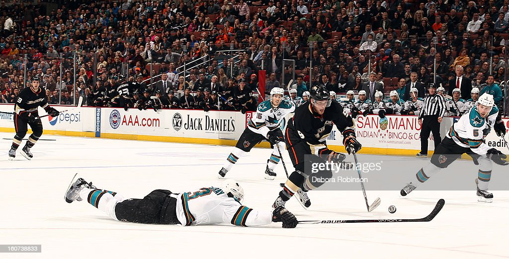 Bobby Ryan #9 of the Anaheim Ducks handles the puck against a diving Douglas Murray #3 of the San Jose Sharks on February 4, 2013 at Honda Center in Anaheim, California.