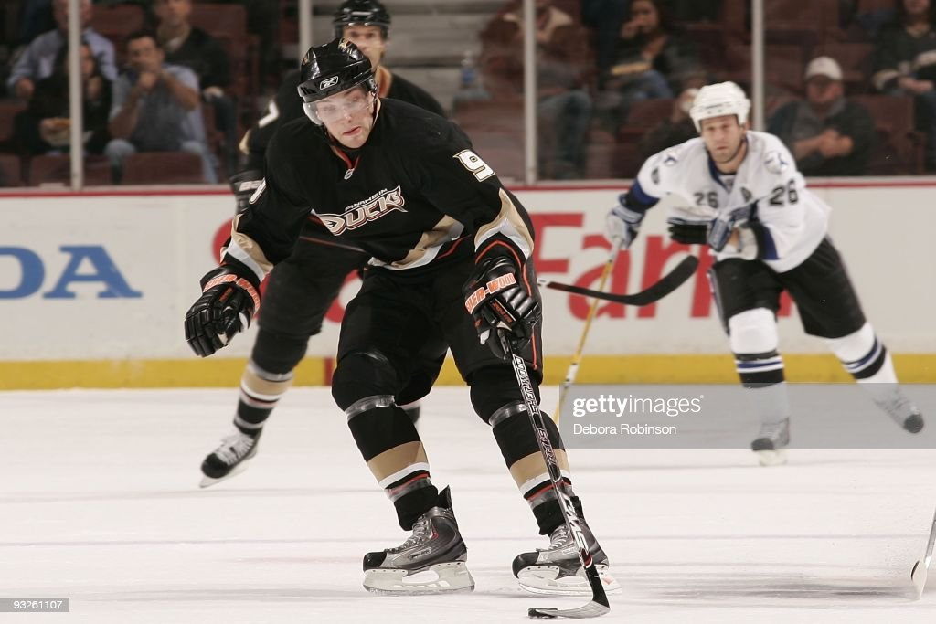 Bobby Ryan of the Anaheim Ducks handles the puck center ice against Alex Tanguay of the Tampa Bay Lighting during the game on November 19 2009 at...