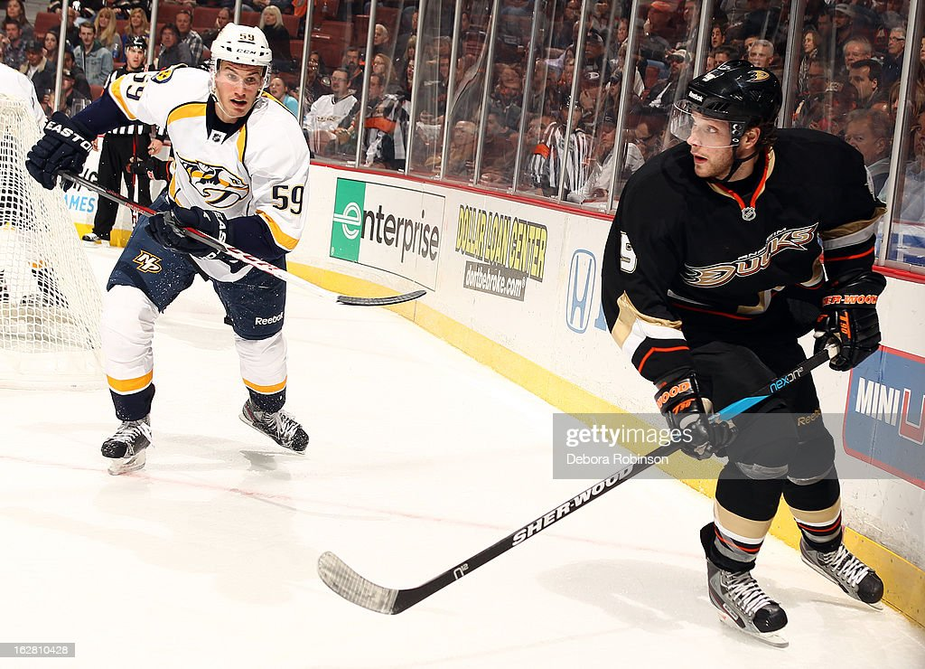 <a gi-track='captionPersonalityLinkClicked' href=/galleries/search?phrase=Bobby+Ryan&family=editorial&specificpeople=877359 ng-click='$event.stopPropagation()'>Bobby Ryan</a> #9 of the Anaheim Ducks skates during the game as <a gi-track='captionPersonalityLinkClicked' href=/galleries/search?phrase=Roman+Josi&family=editorial&specificpeople=4247871 ng-click='$event.stopPropagation()'>Roman Josi</a> #59 of the Nashville Predators closes in during the game on February 27, 2013 at Honda Center in Anaheim, California.