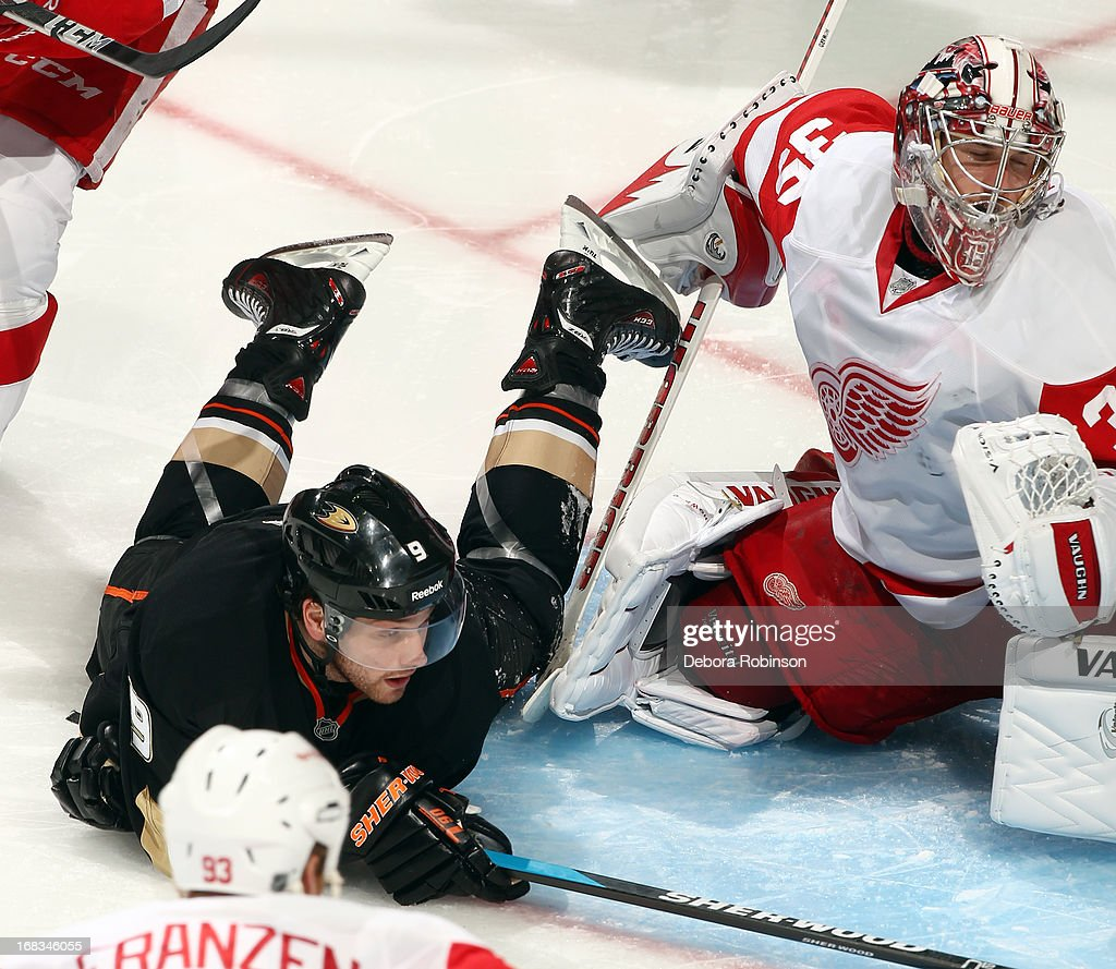 Bobby Ryan #9 of the Anaheim Ducks slides in front of goaltender Jimmy Howard #35 of the Detroit Red Wings in Game Five of the Western Conference Quarterfinals during the 2013 NHL Stanley Cup Playoffs at Honda Center on May 8, 2013 in Anaheim, California.
