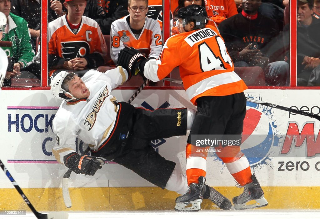 Bobby Ryan of the Anaheim Ducks takes a hit from Kimmo Timonen of the Philadelphia Flyers on October 21 2010 at Wells Fargo Center in Philadelphia...